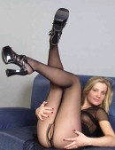 Hot baby in pantyhose shows her pussy